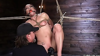 Gagged beauty suffers in extreme hogtie