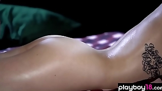 Busty brunette babes sensual massage on podium outdoor