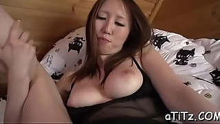 Breasty oriental babe spreads her legs for lusty pussy shaving