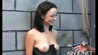 Guy plays harsh on babe'_s pussy in extreme bondage